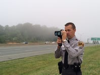 """NC Trooper Chris Knox uses the """"Lidar"""" speed measure device to pinpoint speeders traveling this holiday weekend."""