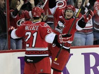 The Charlotte Checkers' Zac Dalpe (19) celebrates his goal with teammate Tim Wallace (21) during the second period as they play the Norfolk Admirals in an American Hockey League game at the PNC Arena on Sunday, January 6, 2013, in Raleigh, North Carolina. The Checkers are the Carolina Hurricanes highest-level minor league franchise. The NHL announced an agreement with the players union on the lockout Sunday. (Chris Seward/Raleigh News & Observer/MCT via Getty Images)