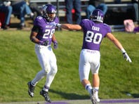 Nov 29, 2014; Evanston, IL, USA; Northwestern Wildcats running back Justin Jackson (left) celebrates scoring a touchdown with wide receiver Austin Carr (right) during the second half against the Illinois Fighting Illini at Ryan Field. Illinois won 47-33. Mandatory Credit: Dennis Wierzbicki-USA TODAY Sports