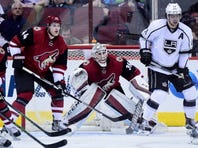Jan 23, 2016; Glendale, AZ, USA; Arizona Coyotes goalie Louis Domingue (35) and defenseman Kevin Connauton (44) defend as Los Angeles Kings center Anze Kopitar (11) looks on during the second period at Gila River Arena. Mandatory Credit: Matt Kartozian-USA TODAY Sports
