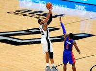 Spurs guard Manu Ginobili, going up for a layup in the season-opening win over the Brooklyn Nets, is averaging 11 points and 3.8 assists.