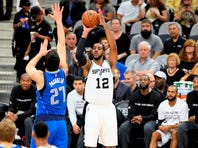 LaMarcus Aldridge, shooting against Dallas Mavericks center Zaza Pachulia, scored a season-high 26 points in the Spurs' record 119-68 win over the 76ers on Monday night.