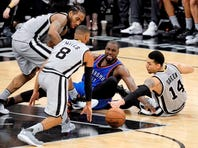 Spurs guard Danny Green beats Oklahoma City's Russell Westbrook to a loose ball in Saturday night's victory over the Thunder.