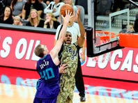 Kawhi Leonard, driving against Charlotte's Nicolas Batum, scored 23 points in the Spurs' 114-94 victory over the Hornets on Nov. 7 at the AT&T Center.