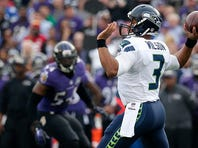 BALTIMORE, MD - DECEMBER 13: Quarterback Russell Wilson #3 of the Seattle Seahawks passes the ball against the Baltimore Ravens in the second quarter at M&T Bank Stadium on December 13, 2015 in Baltimore, Maryland. (Photo by Rob Carr/Getty Images)