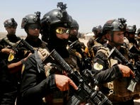 Iraq's elite counter-terrorism forces prepare ahead of an operation to re-take the Islamic State-held city of Fallujah on May 29, 2016.