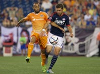 Aug 15, 2015; Foxborough, MA, USA; Houston Dynamo midfielder Alex (14) dribbles for the ball as New England Revolution defender Chris Tierney (8) defends in the first half at Gillette Stadium. Mandatory Credit: David Butler II-USA TODAY Sports