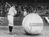 Baseball player Babe Ruth (George Herman Ruth, 1895 - 1948) taking a swipe at an enormous ball.
