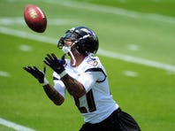 May 28, 2015; Baltimore, MD, USA; Baltimore Ravens cornerback Asa Jackson (27) catches a punt during training camp at the Under Armour Performance Center. Mandatory Credit: Evan Habeeb-USA TODAY Sports