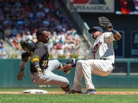 Minnesota Twins third baseman Eduardo Nunez (9) gets called for interference against Pittsburgh Pirates center fielder Andrew McCutchen (22) in the sixth inning at Target Field.