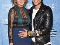 "Model Chrissy Teigen (L) and recording artist John Legend attend A+E Networks ""Shining A Light"" concert at The Shrine Auditorium on November 18, 2015 in Los Angeles, California."
