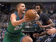 Dallas Mavericks forward Chandler Parsons (25) drives to the basket past Minnesota Timberwolves guard Andrew Wiggins (22) during the first quarter at the American Airlines Center on January 20, 2016.
