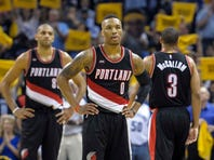 Apr 19, 2015; Memphis, TN, USA; Portland Trail Blazers guard Damian Lillard (0) Portland Trail Blazers forward Nicolas Batum (88) and Portland Trail Blazers guard C.J. McCollum (3) during the game against the Memphis Grizzlies in game one of the first round of the NBA Playoffs at FedExForum. Memphis Grizzlies beat Portland Trail Blazers 100 -86.Mandatory Credit: Justin Ford-USA TODAY Sports