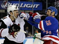 Oct 22, 2015; New York, NY, USA; New York Rangers center Dominic Moore (28) and Arizona Coyotes center Martin Hanzal (11) fight during the first period of an NHL hockey game at Madison Square Garden. Mandatory Credit: Adam Hunger-USA TODAY Sports