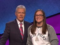 """""""Jeopardy!"""" host Alex Trebek poses with U.S. Military Academy senior Carissa Pekny during a taping of the show's annual college tournament."""