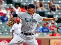 Seattle Mariners starting pitcher Mike Montgomery (37) throws a pitch in the first inning against the Texas Rangers at Globe Life Park in Arlington on August 19, 2015.