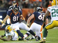 Nov 1, 2015; Denver, CO, USA; Denver Broncos tight end Owen Daniels (81) runs with the ball after evading a tackle from Green Bay Packers outside linebacker Mike Neal (96) during the first half at Sports Authority Field at Mile High. The Broncos won 29-10.