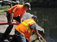 Coldspring workers pump water from Quarry 8 at the Quarry Park & Nature Reserve. Divers have been unable to find the body of a St. Cloud man believed to have committed suicide there.