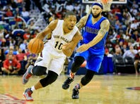 Nov 10, 2015; New Orleans, LA, USA; New Orleans Pelicans guard Eric Gordon (10) drives past Dallas Mavericks guard Deron Williams (8) during the second half of a game at the Smoothie King Center. The Pelicans defeated the Mavericks 120-105. Mandatory Credit: Derick E. Hingle-USA TODAY Sports