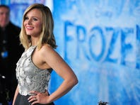 """HOLLYWOOD, CA - NOVEMBER 19:  Actress Kristen Bell attends the premiere of Walt Disney Animation Studios' """"Frozen""""at the El Capitan Theatre on November 19, 2013 in Hollywood, California.  (Photo by Frazer Harrison/Getty Images)"""