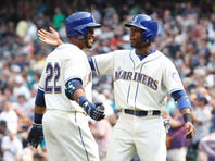 Aug 23, 2015; Seattle, WA, USA; Seattle Mariners designated hitter Robinson Cano (22) his congratulated by center fielder Austin Jackson (16) after Cano hit a 2-run home run in the fifth inning against the Chicago White Sox at Safeco Field. Mandatory Credit: Jennifer Buchanan-USA TODAY Sports