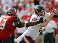 Tampa Bay Buccaneers defensive tackle Gerald McCoy (93) puts the pressure on Chicago Bears quarterback Jay Cutler (6) during the second quarter of a football game at Raymond James Stadium.