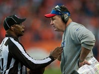 DENVER, CO - DECEMBER 7:  Head coach Doug Marrone of the Buffalo Bills has a word with field judge Barry Anderson #20 at Sports Authority Field at Mile High on December 7, 2014 in Denver, Colorado.  (Photo by Dustin Bradford/Getty Images)