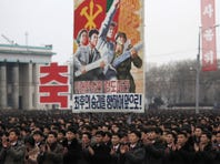 North Koreans gather at the Kim Il Sung Square on Feb. 8, 2016, to celebrate a satellite launch in Pyongyan.