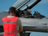 An F-16 pilot from the 480th Fighter Squadron, Spangdahlem Air Base, Germany, conducts pre-flight checks before take off at Beja Air Base, Portugal on  Oct. 21, in support of Exercise Trident Juncture 2015.