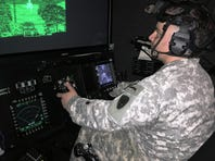 A Soldier at the Hunter Army Airfield, Ga., trains in a helicopter simulator as part of an assessment of a new training capability. During the assessment, Soldiers at Hunter Army Airfield and Fort Rucker, Ala., were in the Aviation Combined Arms Tactical Trainer, a helicopter simulator.