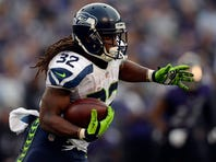 Seattle Seahawks running back DuJuan Harris (32) rushes during the second half against the Baltimore Ravens at M&T Bank Stadium. Seattle Seahawks defeated Baltimore Ravens 35-6.