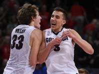March 7, 2016; Las Vegas, NV, USA; Gonzaga Bulldogs forward Kyle Wiltjer (33) celebrates with guard Kyle Dranginis (3) after the game in the semifinals of the West Coast Conference tournament at Orleans Arena. Mandatory Credit: Kyle Terada-USA TODAY Sports