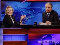 "In this July 15, 2014 file photo, former U.S. Secretary of State Hillary Rodham Clinton reacts to host Jon Stewart during a taping of ""The Daily Show with Jon Stewart,"" in New York. Stewart enters the home stretch of his 16 years on Comedy Central's ""The Daily Show"" on Monday, with 12 more nights of jokes at the expense of those who make and report the news before he signs off for good on Aug. 6."