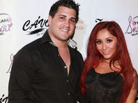"Jionni LaValle (L) and Nicole ""Snooki"" Polizzi attends Nicole ""Snooki"" Polizzi  birthday at Cavo on December 6, 2013 in New York City.  (Photo by Robin Marchant/Getty Images)"