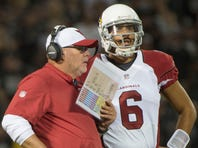August 30, 2015; Oakland, CA, USA; Arizona Cardinals head coach Bruce Arians (left) instructs quarterback Logan Thomas (6) during the fourth quarter in a preseason NFL football game against the Oakland Raiders at O.co Coliseum. The Cardinals defeated the Raiders 30-23.