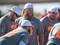 Team Irvin guard Marshal Yanda of the Baltimore Ravens (73, left), center Nick Mangold of the New York Jets (74, center), and guard Zack Martin of the Dallas Cowboys (70, right) smile during the 2015 Pro Bowl practice