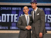 Frank Kaminsky (Wisconsin) greets NBA commissioner Adam Silver after being selected as the number nine overall pick to the Charlotte Hornets in the first round of the 2015 NBA Draft at Barclays Center.