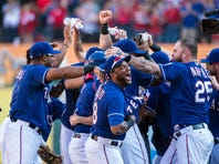 The Texas Rangers celebrate their win over the Los Angeles Angels at Globe Life Park in Arlington