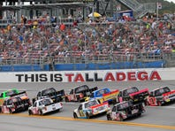 Oct 24, 2015; Talladega, AL, USA; Camping World Truck Series drivers race during the Fred's 250 presented by Coca-Cola at Talladega Superspeedway. Mandatory Credit: Marvin Gentry-USA TODAY Sports