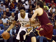 NEW ORLEANS, LA - DECEMBER 04:  Anthony Davis #23 of the New Orleans Pelicans works against Kevin Love #0 of the Cleveland Cavaliers during the first half of a game at the Smoothie King Center on December 4, 2015 in New Orleans, Louisiana. NOTE TO USER: User expressly acknowledges and agrees that, by downloading and or using this photograph, User is consenting to the terms and conditions of the Getty Images License Agreement.  (Photo by Stacy Revere/Getty Images)