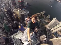 A video of some crazy teens on top of a  Hong Kong skyscraper is making the rounds on social media