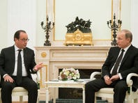 Russian President Vladimir Putin, right, listens to France's President Francois Hollande during their meeting in Moscow, Russia, on Nov. 26, 2015.