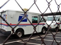 US Postal Service mail delivery trucks sit idle at the Manassas Post Office in Virginia on September 5, 2011. The New York Times reported that the US Postal Service is on the brink of default unless Congress takes emergency action to shore up finances.