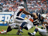SAN DIEGO, CA - DECEMBER 06:   Malik Jackson #97 of the Denver Broncos and  Von Miller #58 of the Denver Broncos sack  Philip Rivers #17 of the San Diego Chargers during the fourth quarter of a game at Qualcomm Stadium on December 6, 2015 in San Diego, California.  (Photo by Sean M. Haffey/Getty Images)