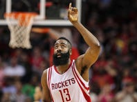 Mar 18, 2016; Houston, TX, USA; Houston Rockets guard James Harden (13) reacts after scoring a basket during the third quarter against the Minnesota Timberwolves at Toyota Center. Mandatory Credit: Troy Taormina-USA TODAY Sports