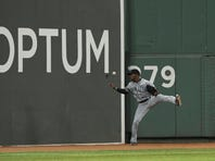 Aug 14, 2015; Boston, MA, USA; Seattle Mariners center fielder Austin Jackson (16) tries to get a hold of the ball during the third inning against the Boston Red Sox at Fenway Park. Mandatory Credit: Bob DeChiara-USA TODAY Sports