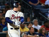 Freddie Freeman #5 of the Atlanta Braves hits a two-RBI double during the eighth inning against the Philadelphia Phillies at Turner Field on September 19, 2015 in Atlanta, Georgia.