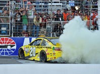 NASCAR Sprint Cup Series driver Matt Kenseth (20) celebrates with a burn out after winning the Sylvania 300 at New Hampshire Motor Speedway. He will start on the pole at Dover.