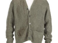 A vintage green cardigan sweater worn by Kurt Cobain during Nirvana's appearance on MTV Unplugged in 1993. The Manhattan brand sweater is a blend of acrylic, mohair and Lycra with five-button closure (one button absent), with two exterior pockets, a burn hole and discoloration near left pocket and discoloration on right pocket, size medium. The sweater was obtained from a close friend of the Cobain family. A signed letter of authenticity and provenance from the Cobain family friend will be provided to the winning bidder.
