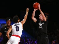 Nov 26, 2015; Paradise Island, BAHAMAS; Texas A&M Aggies guard Alex Caruso (21) shoots as Gonzaga Bulldogs guard Silas Melson (0) defends in the first half during the 2015 Battle 4 Atlantis in the Imperial Arena at the Atlantis Resort..